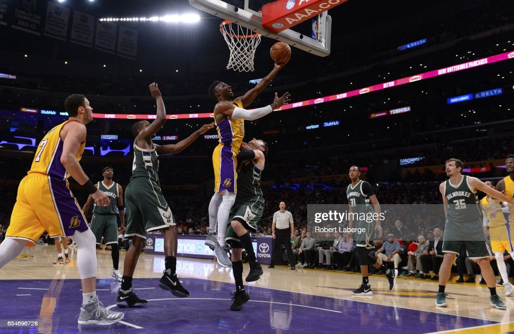 David Nwaba #10 of the Los Angeles Lakers attempts a lay up against Matthew Dellavedova #8 of the Milwaukee Bucks on March 17, 2017 at STAPLES Center in Los Angeles, California.