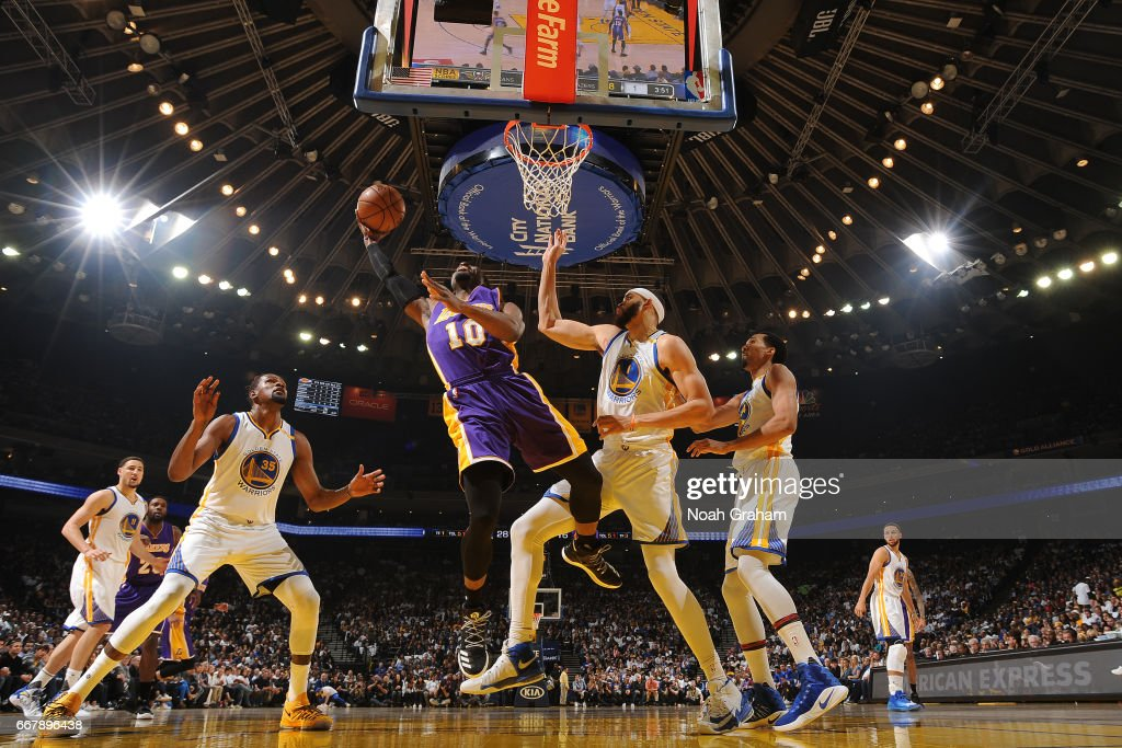 David Nwaba #10 of the Los Angeles Lakers goes to the basket against the Golden State Warriors on April 12, 2017 at ORACLE Arena in Oakland, California.