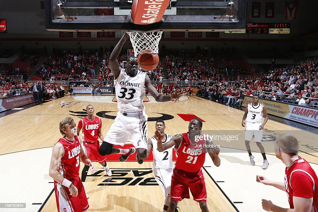 David Nyarsuk #33 of the Cincinnati Bearcats dunks the ball against the New Mexico Lobos during the game at Fifth Third Arena on December 27, 2012 in Cincinnati, Ohio. New Mexico won 55-54.