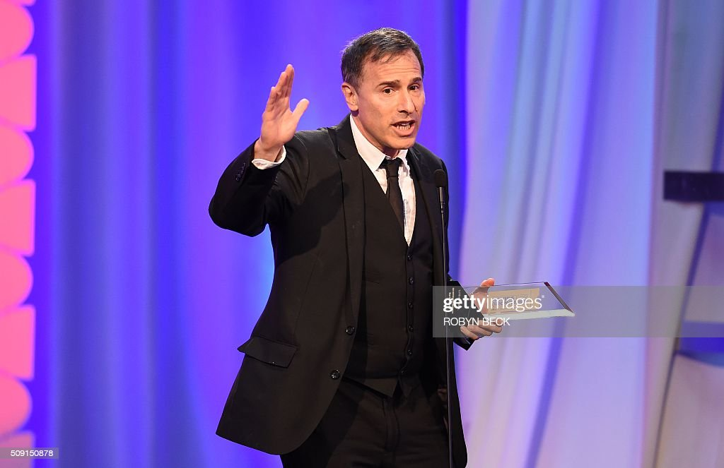 David O. Russell accepts the award for Best ScreenWriter for 'Joy,' on stage at the AARP 15th Annual Movies For Grownups Awards, February 8, 2016, at the Beverly Wilshire Hotel in Beverly Hills, California. / AFP / ROBYN BECK