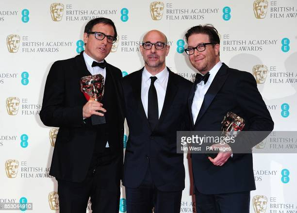 David O Russell and Eric Warren Singer with the award for Best Original Screenplay for 'American Hustle' alongside presenter Stanley Tucci at The EE...