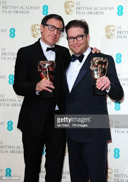 David O Russell and Eric Warren Singer with the award for Best Original Screenplay for 'American Hustle' at The EE British Academy Film Awards 2014...