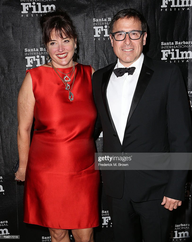 <a gi-track='captionPersonalityLinkClicked' href=/galleries/search?phrase=David+O.+Russell&family=editorial&specificpeople=215306 ng-click='$event.stopPropagation()'>David O. Russell</a> (R) and his guest attend the SBIFF's 2012 Kirk Douglas Award for Excellence In Film during the Santa Monica Film Festival on December 8, 2012 in Goleta, California.