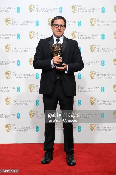 David O Russell with the award for Best Adapted Screenplay for 'Silver Linings Playbook' in the press room at the 2013 British Academy Film Awards at...