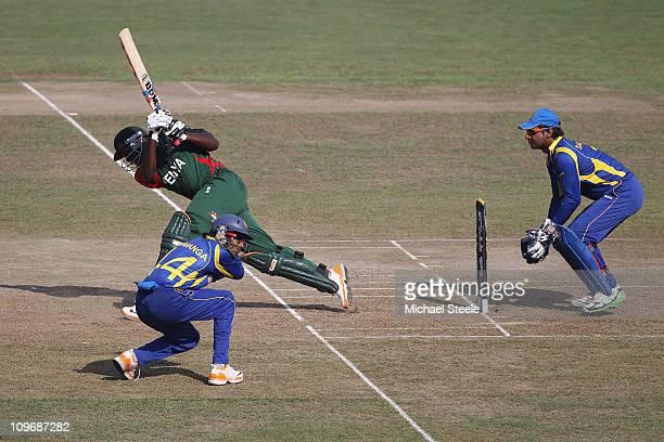 David Obuya of Kenya hits to the legsde as wicketkeeper Kumar Sangakkara looks on and Upul Tharanga takes cover during the Kenya v Sri Lanka 2011 ICC...