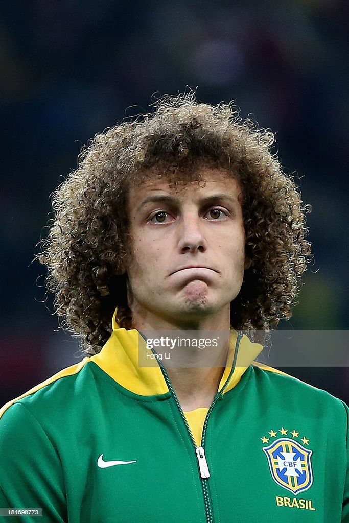 David of Brazil poses during the international friendly match between Brazil and Zambia at Beijing National Stadium on October 15, 2013 in Beijing, China.