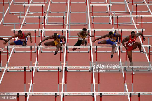 David Oliver of the United States leads the field on his way to winning the 110 meter hurdles final during Day 14 of the Toronto 2015 Pan Am Games on...