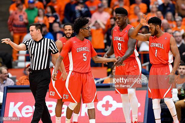 David Onuorah and Darryl Smith of the Cornell Big Red react to a play by Robert Hatter of the Cornell Big Red against the Syracuse Orange during the...