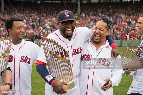 David Oritz of the Boston Red Sox laughs with former teammate Manny Ramirez during a ceremony honoring him before his final regular season game on...