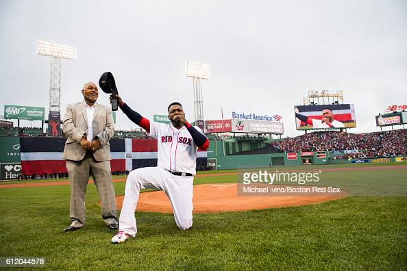 David Oritz of the Boston Red Sox thanks the fans while giving a speech accompanied by his father Leo during a ceremony honoring him before his final...