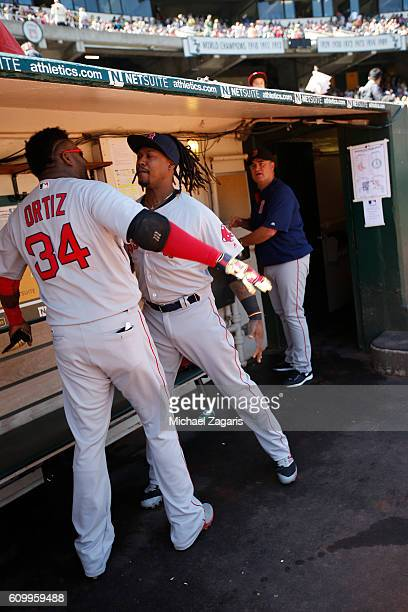 David Ortiz and Hanley Ramirez of the Boston Red Sox bump chest in the dugout prior to the game against the Oakland Athletics at the Oakland Coliseum...