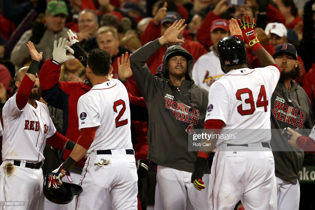 David Ortiz and Jacoby Ellsbury of the Boston Red Sox return to the dugout after scoring in the third inning against the St Louis Cardinals during...