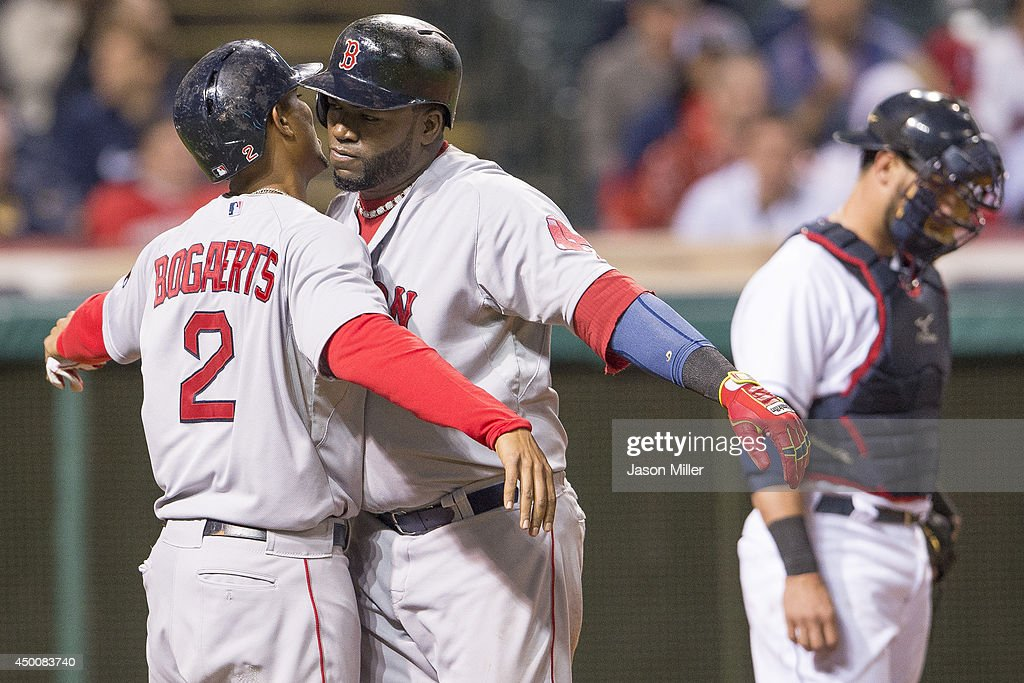 <a gi-track='captionPersonalityLinkClicked' href=/galleries/search?phrase=David+Ortiz&family=editorial&specificpeople=175825 ng-click='$event.stopPropagation()'>David Ortiz</a> #34 and <a gi-track='captionPersonalityLinkClicked' href=/galleries/search?phrase=Xander+Bogaerts&family=editorial&specificpeople=9461957 ng-click='$event.stopPropagation()'>Xander Bogaerts</a> #2 of the Boston Red Sox celebrate Ortiz's two-run home run during the sixth inning against the Cleveland Indians at Progressive Field on June 4, 2014 in Cleveland, Ohio.