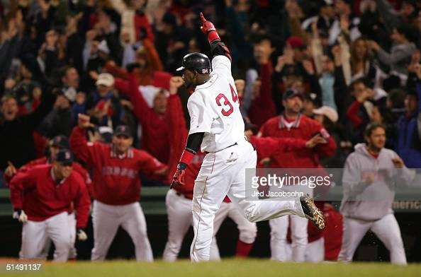 David Ortiz celebrates after hitting the game winning tworun home run against the New York Yankees in the twelfth inning during game four of the...