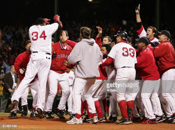 David Ortiz celebrates after hitting the game winning tworun home run against the New York Yankees in the twelth inning during game four of the...