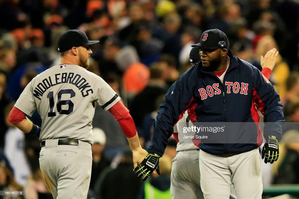 <a gi-track='captionPersonalityLinkClicked' href=/galleries/search?phrase=David+Ortiz&family=editorial&specificpeople=175825 ng-click='$event.stopPropagation()'>David Ortiz</a> #34 celebrates with <a gi-track='captionPersonalityLinkClicked' href=/galleries/search?phrase=Will+Middlebrooks&family=editorial&specificpeople=7934204 ng-click='$event.stopPropagation()'>Will Middlebrooks</a> #16 of the Boston Red Sox after they defeated the Detroit Tigers 4 to 3 in Game Five of the American League Championship Series at Comerica Park on October 17, 2013 in Detroit, Michigan.