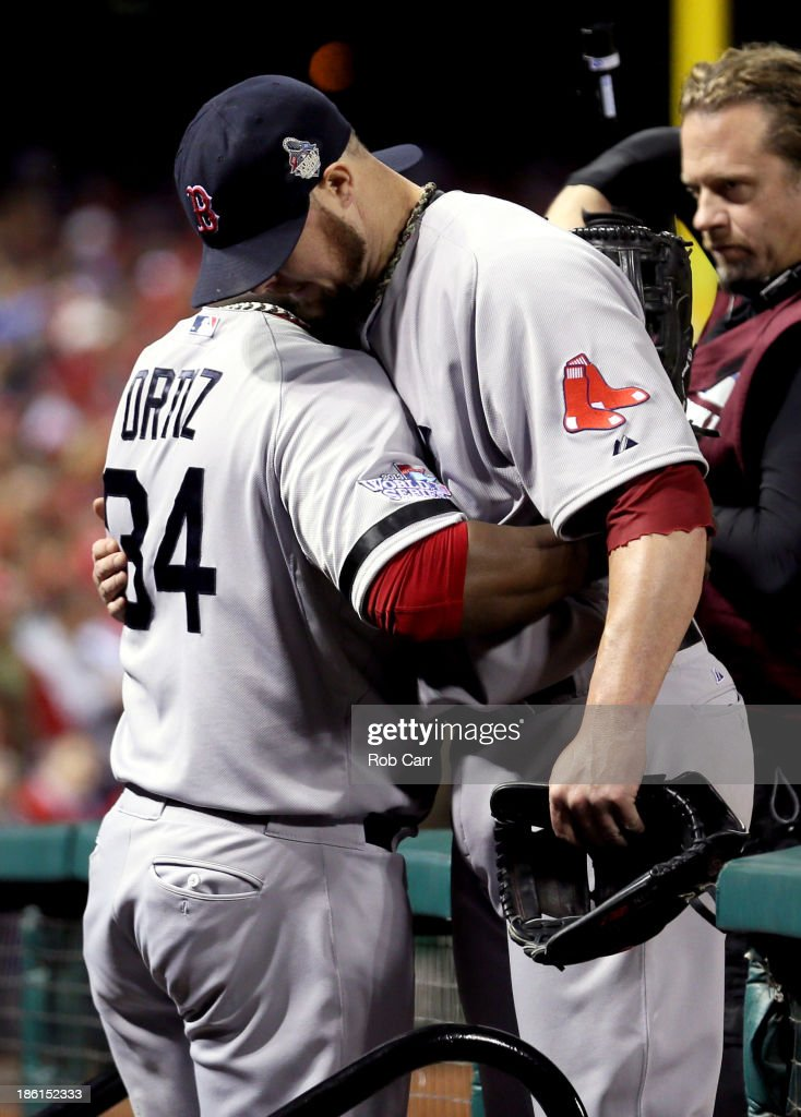 David Ortiz #34 embraces Jon Lester #31 of the Boston Red Sox as he returns to the dugout after being removed from the game in the eighth inning against the St. Louis Cardinals during Game Five of the 2013 World Series at Busch Stadium on October 28, 2013 in St Louis, Missouri.