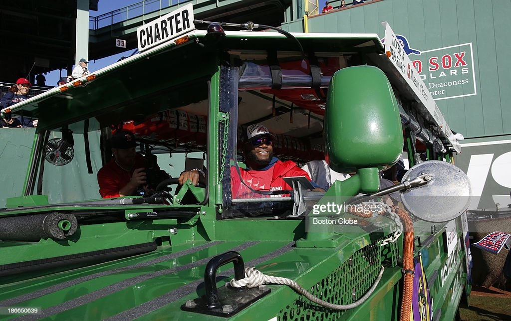 David Ortiz got in the driver's seat of the duck boat and honked the horn a few times to get the attention of his teammates in the vehicle ahead of him before the start of the Rolling Rally duck boat parade to celebrate the Boston Red Sox's World Series victory on Saturday, Nov. 2, 2013.