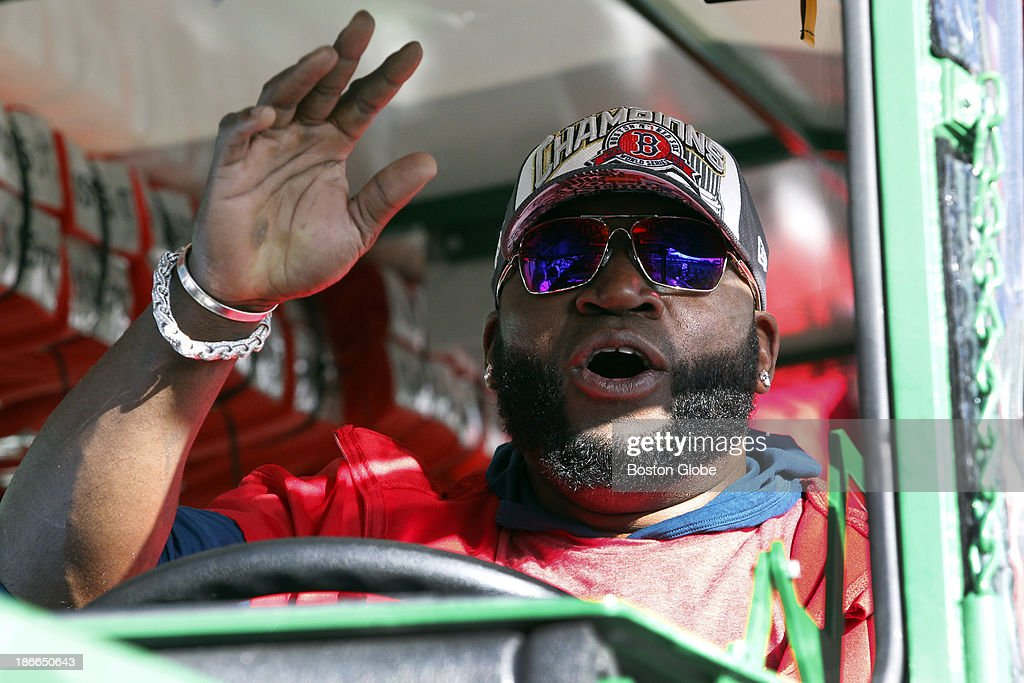 David Ortiz got in the drivers seat of the duck boat and honked the horn a few times to get the attention of his teammates in the vehicle ahead of him before the start of the Rolling Rally duck boat parade to celebrate the Boston Red Sox's World Series victory on Saturday, Nov. 2, 2013.