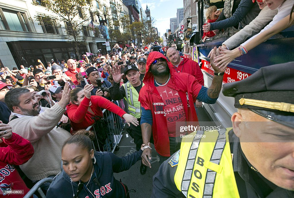David Ortiz greets fans at the Boston Marathon finish line on Boylston Street during the Red Sox's 2013 World Series Rolling Rally victory parade in Boston on Saturday, Nov. 2, 2013.