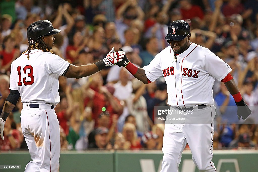David Ortiz high fives Hanley Ramirez of the Boston Red Sox after scoring in the fifth inning during a game against the Tampa Bay Rays at Fenway Park...