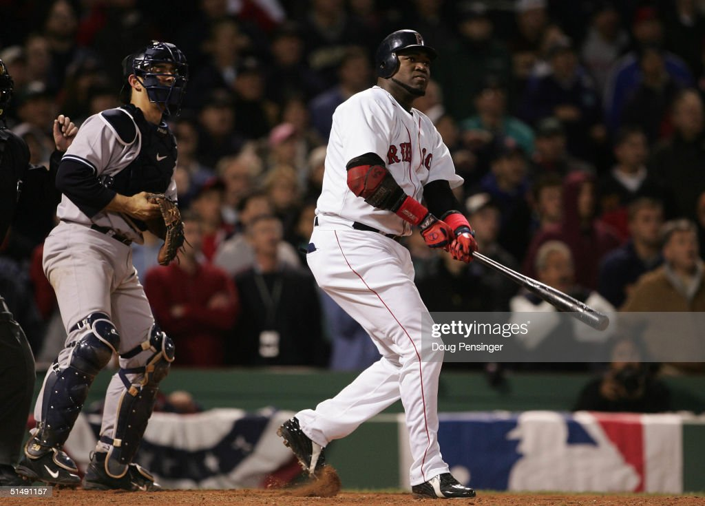 David Ortiz #34 hits the game winning two-run home run against the New York Yankees in the twelth inning during game four of the American League Championship Series on October 17, 2004 at Fenway Park in Boston, Massachusetts.