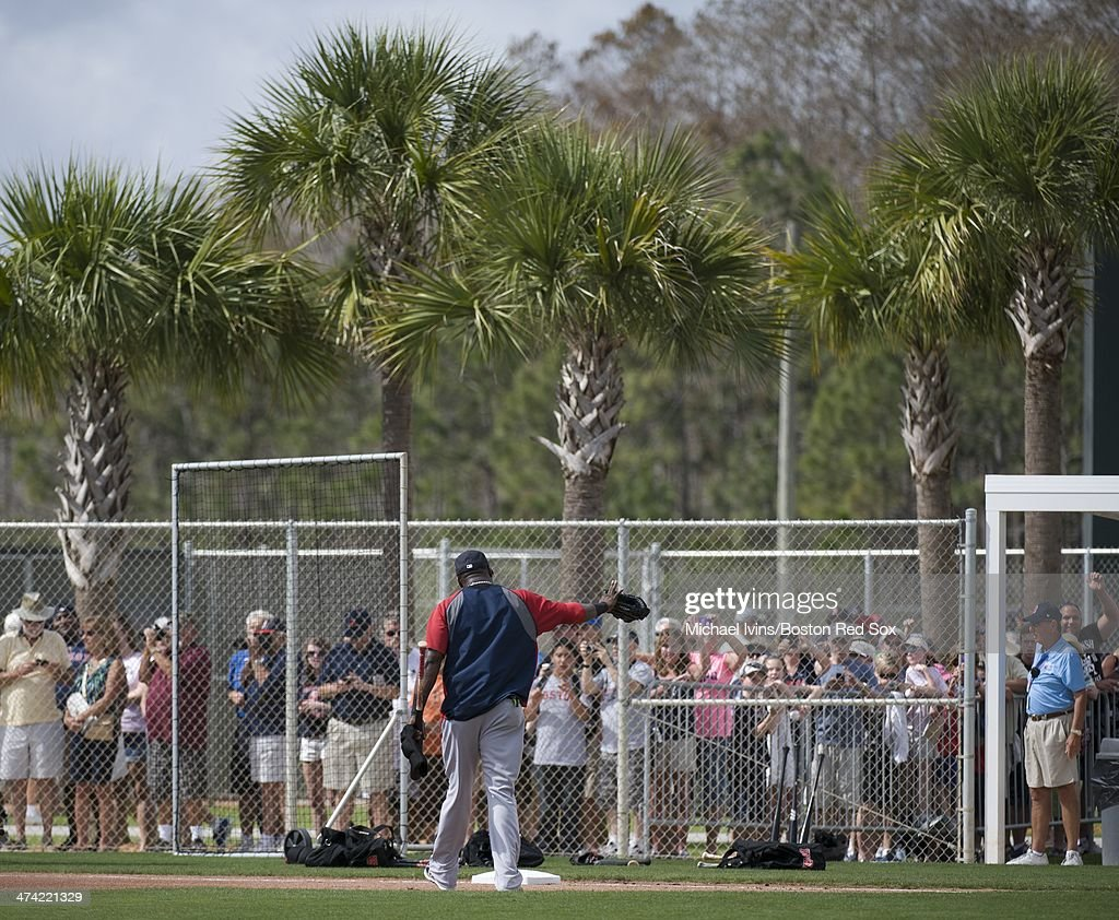 David Ortiz #34 of the Boston Red Sox acknowledges the calls of fans as he walks off the field during a Spring Training workout at Fenway South on February 22, 2014 in Fort Myers, Florida.