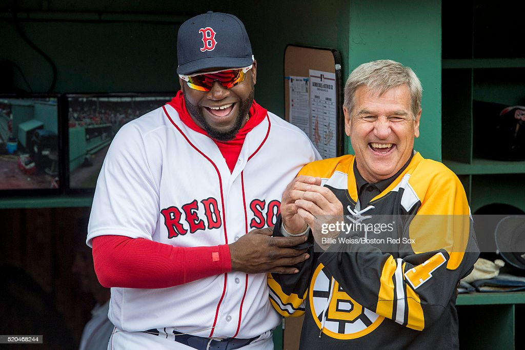 <a gi-track='captionPersonalityLinkClicked' href=/galleries/search?phrase=David+Ortiz&family=editorial&specificpeople=175825 ng-click='$event.stopPropagation()'>David Ortiz</a> #34 of the Boston Red Sox and former Boston Bruins player <a gi-track='captionPersonalityLinkClicked' href=/galleries/search?phrase=Bobby+Orr&family=editorial&specificpeople=204573 ng-click='$event.stopPropagation()'>Bobby Orr</a> react before throwing a ceremonial first pitch during the home opener against the Baltimore Orioles on April 11, 2016 at Fenway Park in Boston, Massachusetts .