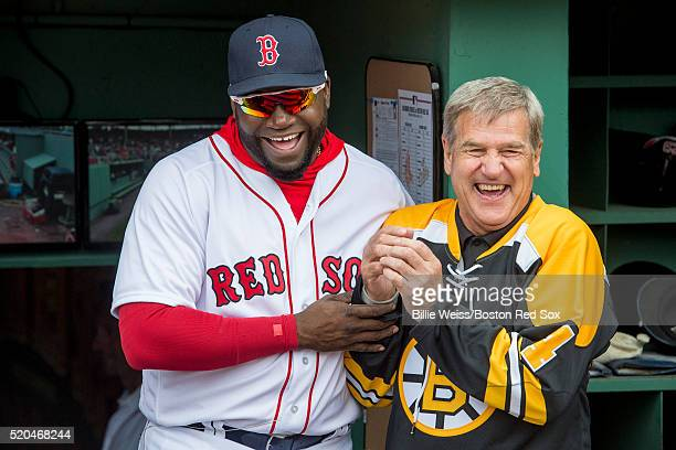 David Ortiz of the Boston Red Sox and former Boston Bruins player Bobby Orr react before throwing a ceremonial first pitch during the home opener...
