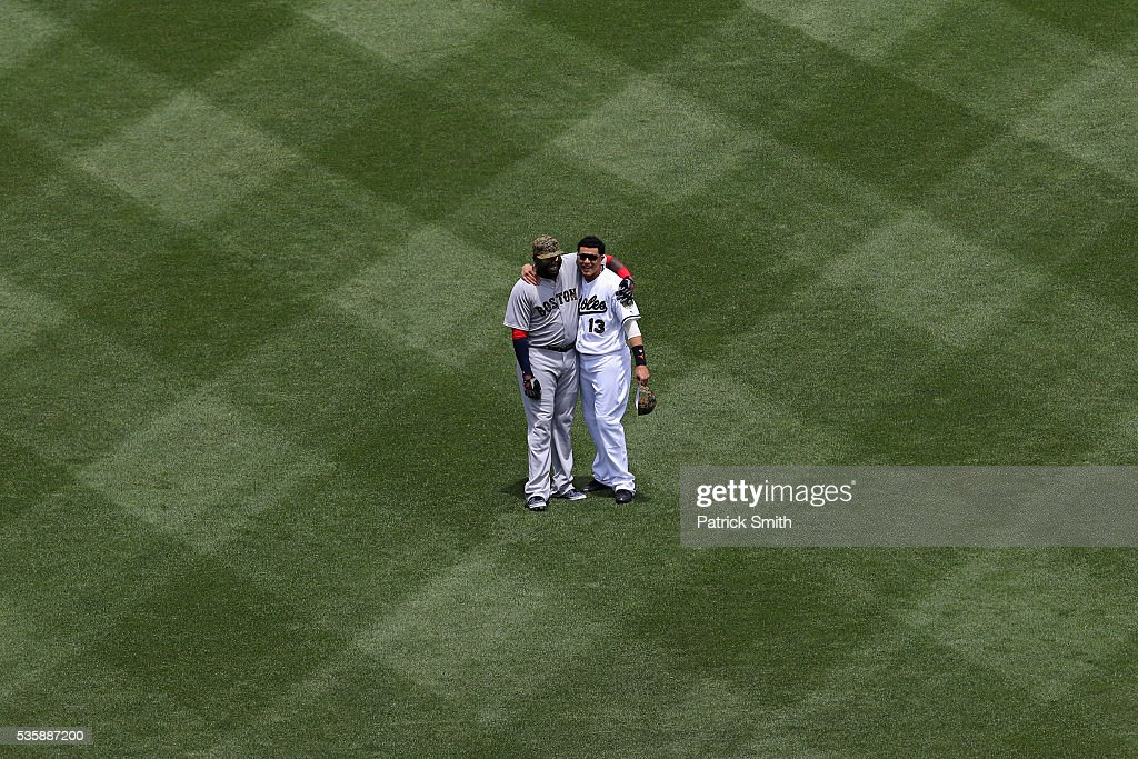 David Ortiz #34 of the Boston Red Sox and Manny Machado #13 of the Baltimore Orioles hug one another before playing at Oriole Park at Camden Yards on May 30, 2016 in Baltimore, Maryland.