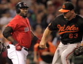 David Ortiz of the Boston Red Sox and pitcher Kevin Gregg of the Baltimore Orioles fight in the bottom of the eighth inning at Fenway Park on July 8...
