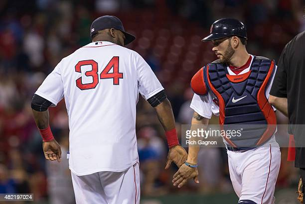 David Ortiz of the Boston Red Sox and teammate Blake Swihart celebrate an 111 victory against the Detroit Tigers at Fenway Park on July 26 2015 in...