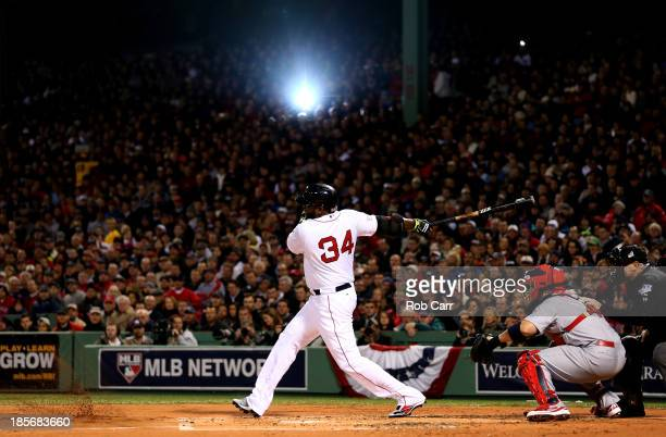 David Ortiz of the Boston Red Sox bats in the first inning against the St Louis Cardinals in the first inning of Game One of the 2013 World Series at...