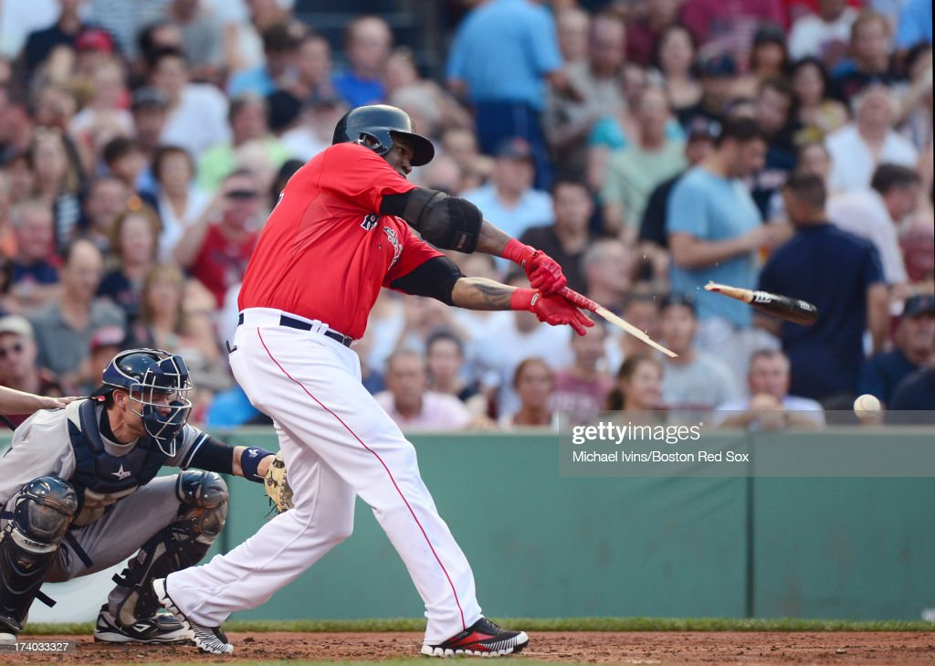 David Ortiz #34 of the Boston Red Sox breaks his bat against the New York Yankees in the first inning on July 19, 2013 at Fenway Park in Boston, Massachusetts.
