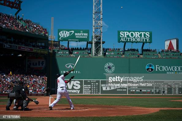 David Ortiz of the Boston Red Sox breaks his bat during the first inning against the New York Yankees at Fenway Park on May 2 2015 in Boston...