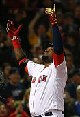 David Ortiz of the Boston Red Sox celebrates a home run in the seventh inning against the New York Yankees at Fenway Park on April 30 2016 in Boston...