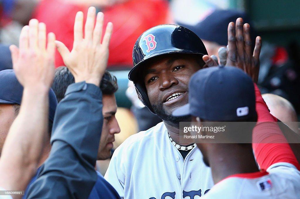David Ortiz #34 of the Boston Red Sox celebrates a run against the Texas Rangers at Rangers Ballpark in Arlington on May 4, 2013 in Arlington, Texas.