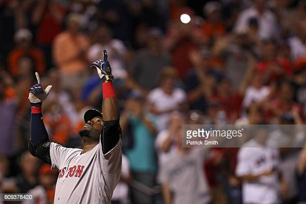 David Ortiz of the Boston Red Sox celebrates a three run home run during the seventh inning against the Baltimore Orioles at Oriole Park at Camden...