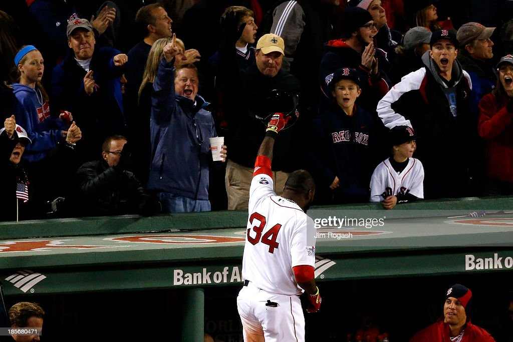 <a gi-track='captionPersonalityLinkClicked' href=/galleries/search?phrase=David+Ortiz&family=editorial&specificpeople=175825 ng-click='$event.stopPropagation()'>David Ortiz</a> #34 of the Boston Red Sox celebrates after hitting a home run in the seventh inning against the St. Louis Cardinals during Game One of the 2013 World Series at Fenway Park on October 23, 2013 in Boston, Massachusetts.