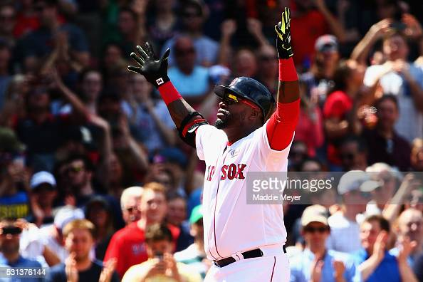 David Ortiz of the Boston Red Sox celebrates after hitting a home run against the Houston Astros during the third inning on May 14 2016 in Boston...