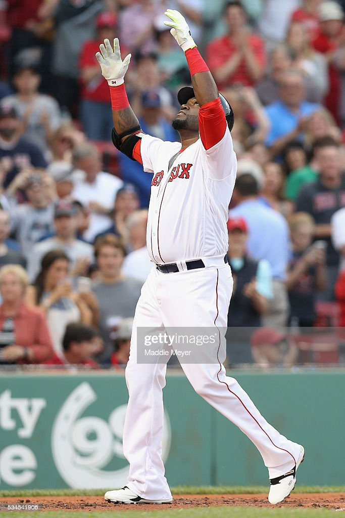<a gi-track='captionPersonalityLinkClicked' href=/galleries/search?phrase=David+Ortiz&family=editorial&specificpeople=175825 ng-click='$event.stopPropagation()'>David Ortiz</a> #34 of the Boston Red Sox celebrates after hitting a two run homer against the Colorado Rockies during the first inning at Fenway Park on May 26, 2016 in Boston, Massachusetts.
