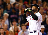 David Ortiz of the Boston Red Sox celebrates after hitting a tworun home run in the fifth inning against the Cleveland Indians during the game at...