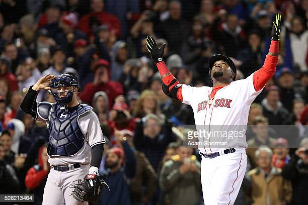 David Ortiz of the Boston Red Sox celebrates after hitting a tworun home run in the eighth inning during the game against the New York Yankees at...