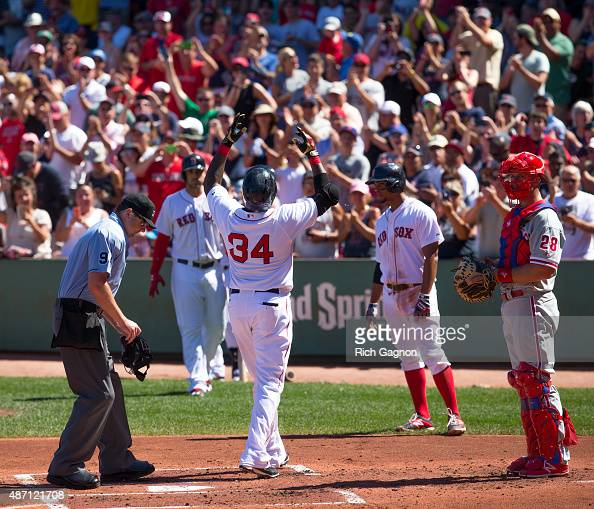 David Ortiz of the Boston Red Sox celebrates at home plate after he hit career home run during the first inning against the Philadelphia Phillies at...