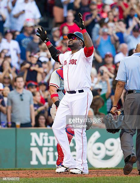 David Ortiz of the Boston Red Sox celebrates his 496th career home run during the fourth inning against the Philadelphia Phillies at Fenway Park on...