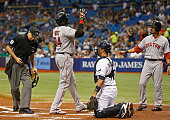 David Ortiz of the Boston Red Sox celebrates his 499th career MLB home run with teammate Mookie Betts in front of catcher JP Arencibia of the Tampa...