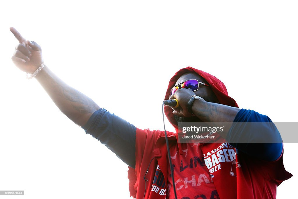 David Ortiz #34 of the Boston Red Sox celebrates on a float during the World Series victory parade on November 2, 2013 in Boston, Massachusetts.