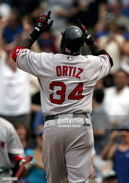 David Ortiz of the Boston Red Sox celebrates the first of his two home runs against the Chicago Cubs in the sixth inning on June 10 2005 at Wrigley...