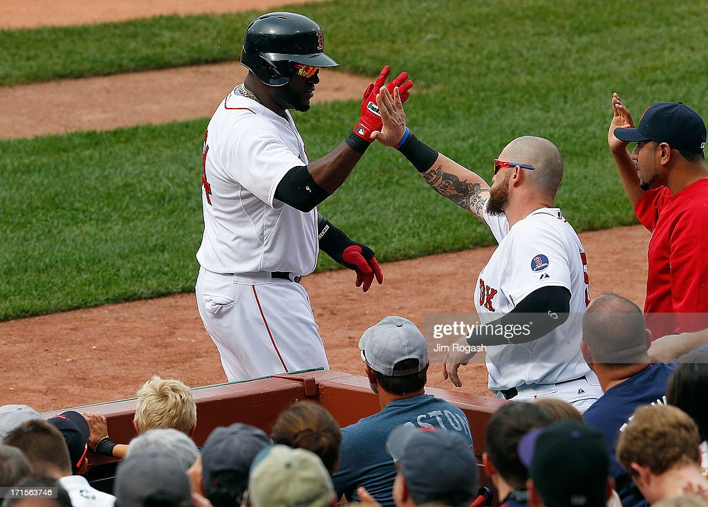 David Ortiz #34 of the Boston Red Sox celebrates with Jonny Gomes after scoring in the 1st inning at Fenway Park on June 26, 2013 in Boston, Massachusetts.