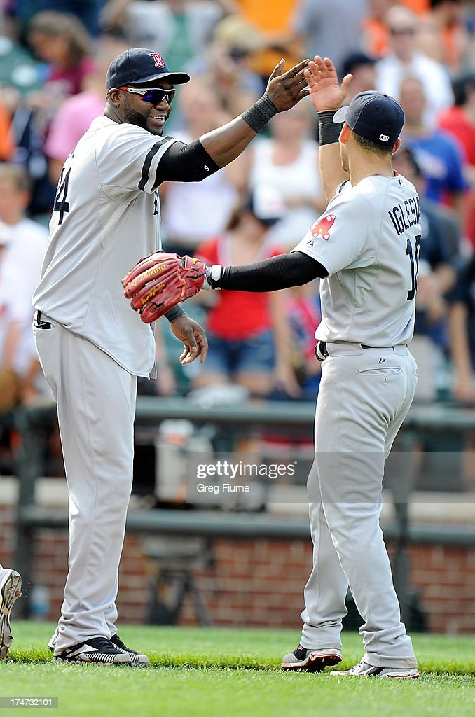<a gi-track='captionPersonalityLinkClicked' href=/galleries/search?phrase=David+Ortiz&family=editorial&specificpeople=175825 ng-click='$event.stopPropagation()'>David Ortiz</a> #34 of the Boston Red Sox celebrates with Jose Iglesias #10 after a 5-0 victory against the Baltimore Orioles at Oriole Park at Camden Yards on July 28, 2013 in Baltimore, Maryland.